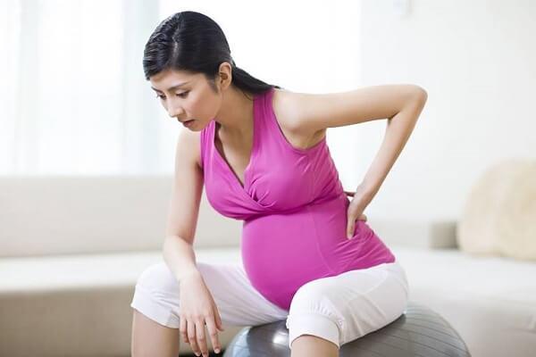 Đau lưng, đau bụng có phải mang thai không?